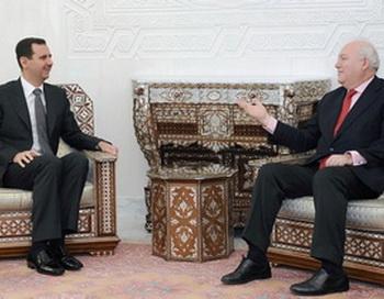 Президент Сирии Башар Эль Асад на встрече с министром иностранных дел Мигелем Мортинс в Дамаске. Фото с сайта epochtimes.co.il