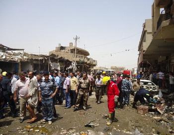 После взрыва бомбы на базаре Дивания, 3 июля 2012 г. Фото: AFP/GettyImages