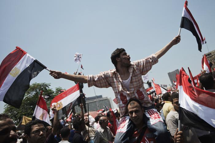 Около 17 миллионов человек вышли на площади Египта 30 июня 2013 года, требуют свержения президента Мухаммеда Мурси. Фото: GIANLUIGI GUERCIA/AFP/Getty Images