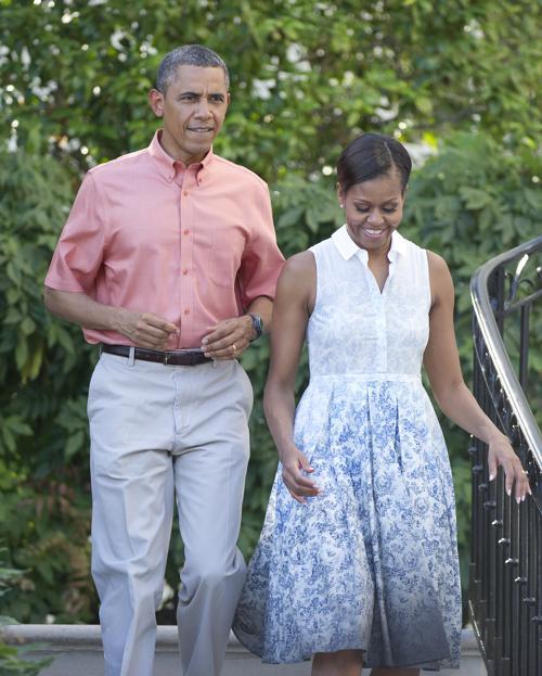 Барак и Мишель Обама пригласили гостей на празднование дня независимости у Белого дома 4 июля 2013 года. Фото: Ron Sachs-Pool/Getty Images