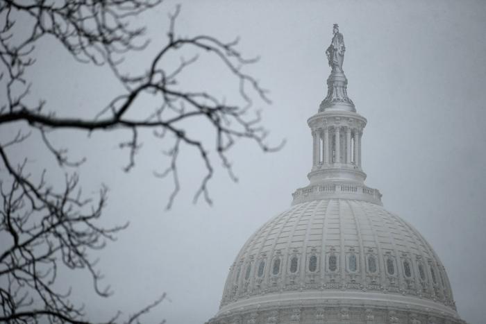 Снегопад в столице США привёл к закрытию школ и госучреждений. Фото: Chip Somodevilla/Getty Images
