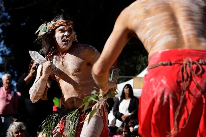 Коренные жители Австралии и жители Торресова пролива празднуют свой праздник NAIDOC вместе с другими жителями Австралии в Сиднее 8 июля 2013 года. Фото: Lisa Maree Williams/Getty Images