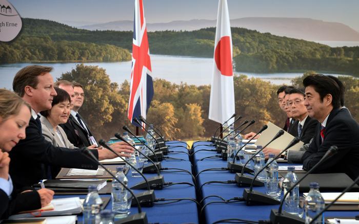 В первый день прошла встреча Дэвида Кэмерона и премьер-министра Японии Синдзо Абэ. Фото: Stefan Rousseau - WPA Pool/Getty Images