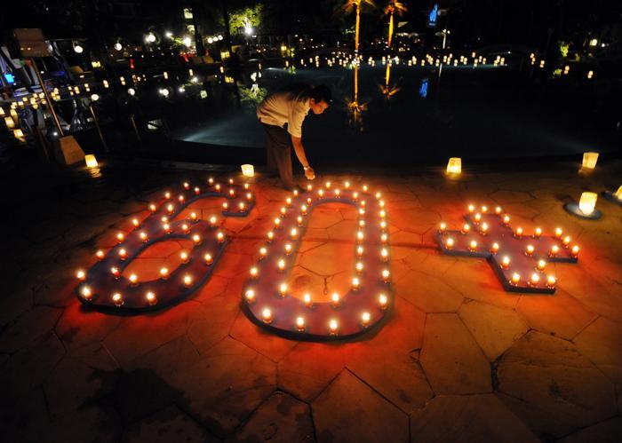В Индонезии прошёл Час Земли. Фото: SONNY TUMBELAKA/AFP/Getty Images