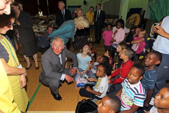 Фоторепортаж  о посещении принцем Чарльзом и герцогиней Корнуольской Камиллой  жителей Лондона, пострадавших в беспорядках. Фото: Phil Hannaford - WPA Pool/Getty Images