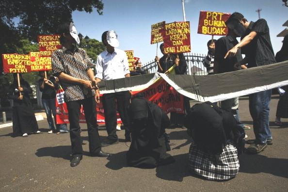 Фоторепортаж о массовой демонстрации в Индонезии за права рабочих-мигрантов. Фото: Ulet Ifansasti/Getty Images