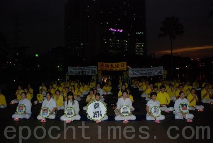 Куала-Лумпур, Малайзия. Акция сторонников Фалуньгун, приуроченная к годовщине начала репрессий Фалуньгун в Китае. Июль 2012 год. Фото: The Epoch Times