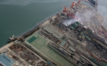 На АЭС «Фукусима-1» утечка радиоактивной воды  остановлена, но предстоят новые испытания. Фото: Фото: NOBORU HASHIMOTO/AFP/Getty Images