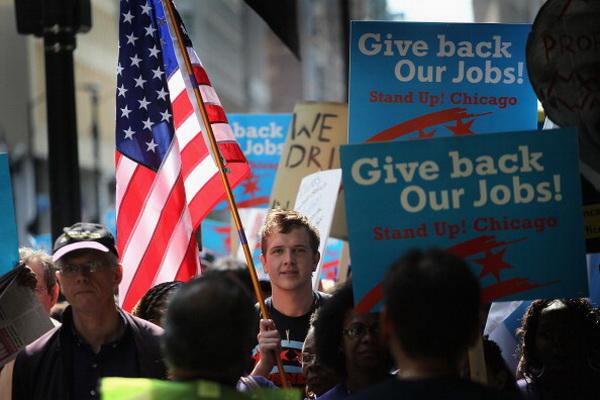 Фоторепортаж об акции протеста против бедственного положения в Чикаго. Фото: Scott Olson/Getty Images