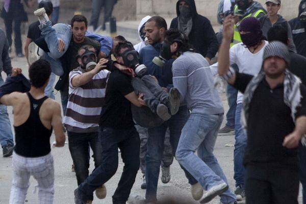 Фоторепортаж с места столкновений манифестантов с полицией в Израиле. Фото: Jalaa Marey/JINI/Getty Images