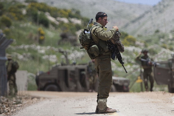 Фоторепортаж об усилении контроля над границей между Израилем и Сирией. Фото: Uriel Sinai/Getty Images