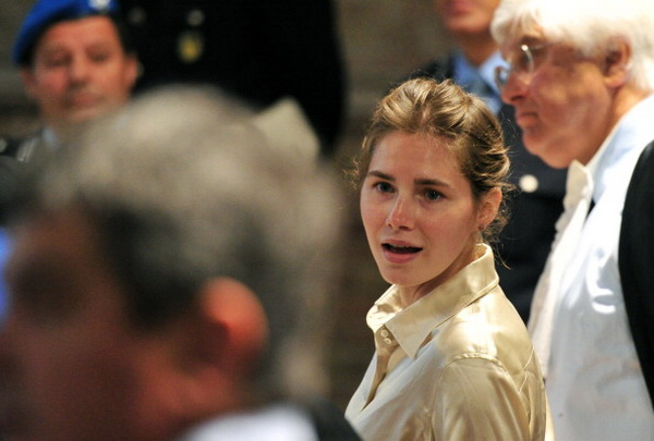 Фоторепортаж о судебном процессе в Италии над американкой Амандой Нокс, обвиняемой в зверском убийстве. Фото: AFP PHOTO / ALBERTO PIZZOLI
