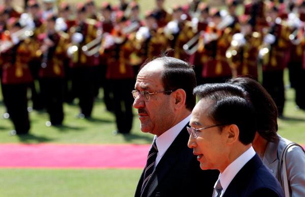 Премьер-министр Ирака Нури аль-Малики встретился с главой  Южной Кореи Ли Мен Баком. Фото: Chung Sung-Jun/Getty Images