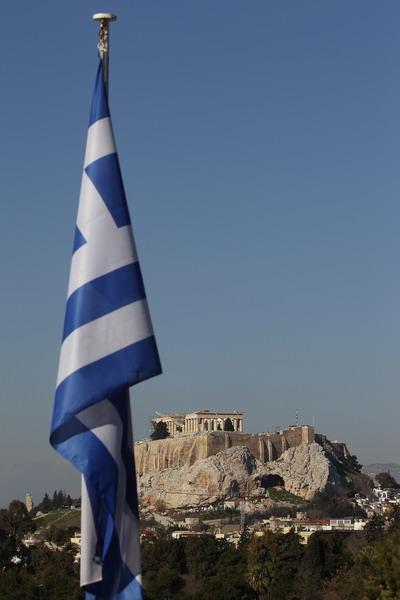 Гособлигации Греции пока не в цене. Фото: Oli Scarff/Getty Images