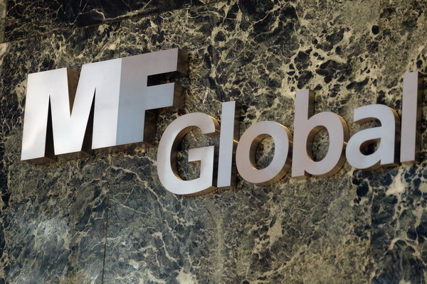 3. Из-за долгов еврозоны обанкротилась брокерская фирма MF Global. Фото: Mario Tama/Getty Images