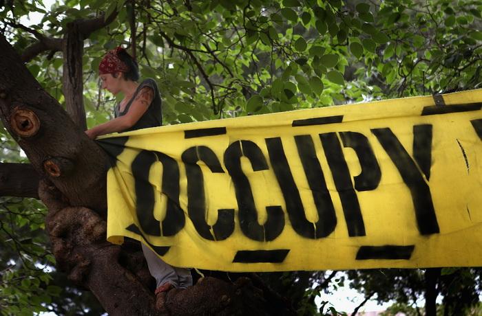 Протесты движения «Оккупируй Уолл-стрит» проходят в Шарлотте, Северная Каролина, 4 сентября 2012 года. Фото:  Scott Olson/Getty Images)