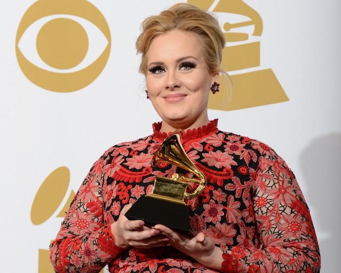 Британские исполнители — самые популярные в мире. Британсакая певица Адель на 55-й церемонии вручения премии «Грэмми» в Лос-Анджелесе 10 февраля 2013 года. Фото: ROBYN BECK/AFP/Getty Images