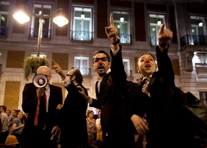 Демонстрация протестов на площади Puerta del Sol в Мадриде, Испания.Участники демонстрации протестуют против коррупции, экономического кризиса и реформ на трудовом рынке. Фото:  Pablo Blazquez Dominguez/Getty Images