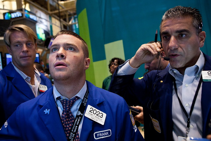 На фондовых торгах в Нью-Йорке. Фото:  Andrew Burton/Getty Images
