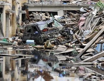 Зона бедствия в Кесеннуме в префектуре Мияги 18 июня 2011 года, 100 дней после стихийного бедствия на северовостоке Японии. Фото: KAZUHIRO NOGI/AFP/Getty Images