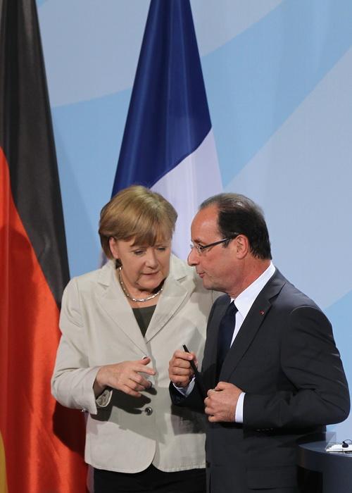 Франция и Германия вселяют уверенность в дальнейшем развитии экономики. ЕС. Встреча главы правительства Германии Ангелы Меркель и Франции Франсуа Олланда в Берлине 15 мая 2012 года. Фото: Sean Gallup/Getty Images