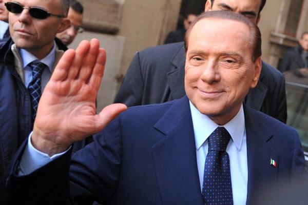 4.Закончилась эра Берлускони. Фото:  ALBERTO PIZZOLI/AFP/Getty Images