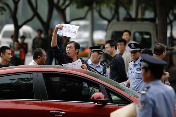 Беспорядки в Китае нанесли ущерб японским производителям и дипломатам. Фото: Lintao Zhang/Getty Images