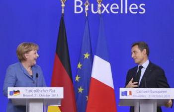 Канцлер германии Ангела Меркель (слева) и президент Франции Николя Саркози во время совместной пресс-конференции в рамках встречи Европейского Совета в штаб-квартире ЕС в Брюсселе 23 октября. Фото с сайта profi-forex.org