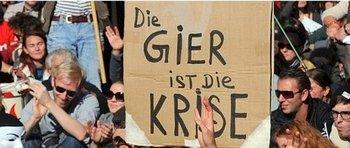 Люди во всем мире протестуют против власти банков. Канцлер Германии Меркель демонстрирует понимание для демонстрантов. На плакате написано: Жадность - это кризис. Фото: derwesten.de