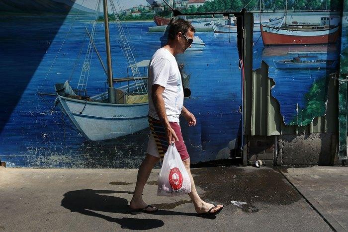 Рыбный рынок в Сиднее, Австралия, готовится к большой предпраздничной продаже 23 декабря 2012 г. Фото: Brendon Thorne/Getty Images
