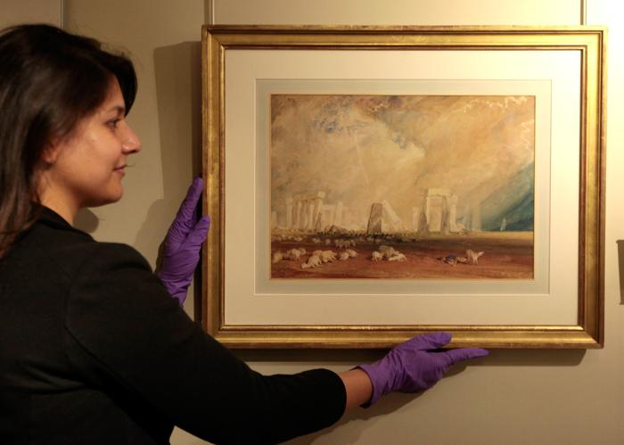 Картина с изображением Стоунхенджа, написанная Уильямом Тёрнером (William Turner) в 1825 г. на выставке «Стоунхендж – монументальное путешествие» в Англии. Фоторепортаж. Фото: Rosie Hallam/Getty Images