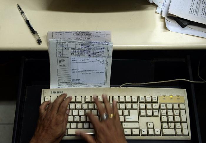 Денежные счета немцев подвергаются массовым атакам хакеров. Фото: PUNIT PARANJPE/AFP/Getty Images