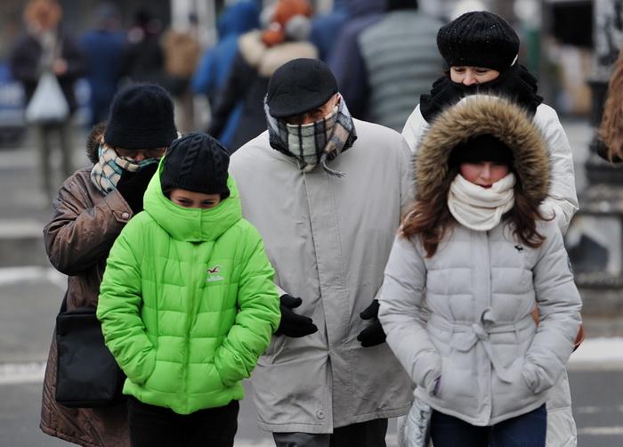 Экстремально холодная погода установилась в США. Фото: STAN HONDA/AFP/Getty Images