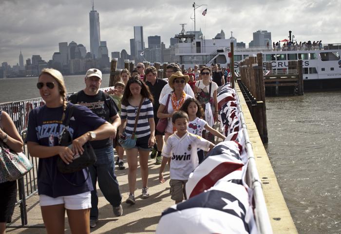 Статуя Свободы вновь открыта для посещений в День независимости США 4 июля 2013 года. Фото:  Kena Betancur/Getty Images