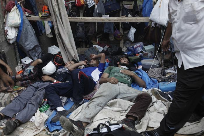 Военные разогнали палаточный лагерь сторонников Мухаммеда Мурси в центре Каира утром 14 августа 2013 года, что привело к столкновениям и сотням погибших. Фото: Ed Giles/Getty Images