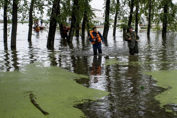 Затопленный посёлок на острове Большой Уссурийский под Хабаровском 20 августа 2013 года. Фото: IGOR CHURAKOV/AFP/Getty Images
