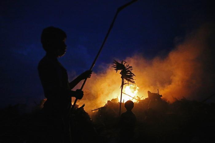 На Филиппинах число жертв тайфуна превысило 4 тысячи человек, по официальным данным на 20 ноября 2013 года. Фото: Dan Kitwood / Getty Images
