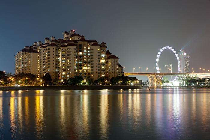Кондоминиум на реке Калланг. Несмотря на недавний спад, строительный бум продолжился в Сингапуре в августе 2013 года. Фото: Nicky Loh/Getty Images