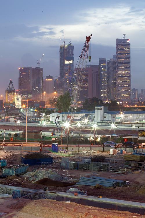 Офисные здания финансовой части Сингапура. Несмотря на недавний спад, строительный бум продолжился в Сингапуре в августе 2013 года. Фото: Nicky Loh/Getty Images