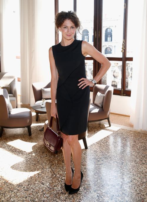 Российская актриса Ксения Раппопорт на фотосессии, организованной знаменитой швейцарской ювелирной компанией Chopard во дворце кино Palazzo del Cinema 3 сентября 2013 года. Фото: Andreas Rentz/Getty Images