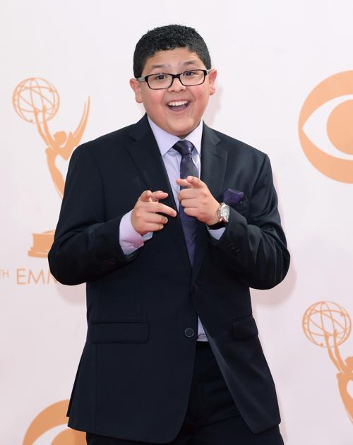 Актёр Рико Родригез прибыл на 65-ю ежегодную церемонию вручения наград «Эмми», которая состоялась в голливудском театре «Нокиа» 22 сентября 2013 года в Лос-Анджелесе, Калифорния (США). Фото: Jason Merritt/Getty Images