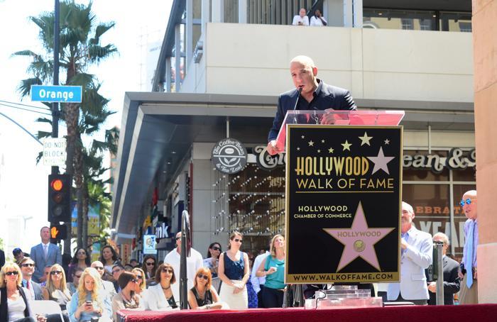 Вин Дизель на торжественной церемонии открытия его звезды на Аллее славы 26 августа 2013 года в Голливуде, штат Калифорния (США). Фото: Frederick M. Brown/Getty Images