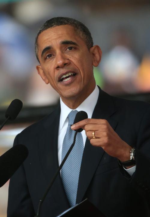 Президент США Барак Обама прибыл на официальную панихиду по Нельсону Манделе в Йоханнесбурге 10 декабря. Фото: Christopher Furlong/Getty Images