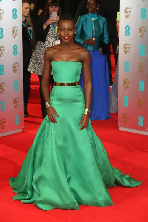 Люпита Нионго прибыла в Лондон 16 февраля на церемонию вручения наград британской киноакадемии BAFTA  2014.Фото: Chris Jackson/Getty Images