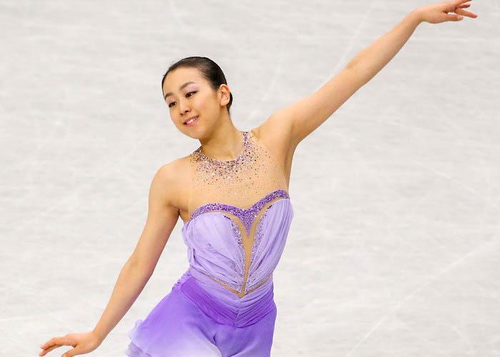 Японская фигуристка Мао Осада стала первой после короткой программы на Чемпионате мира в японском городе Сайтама 27 марта 2014 года. Atsushi Tomura/Getty Images