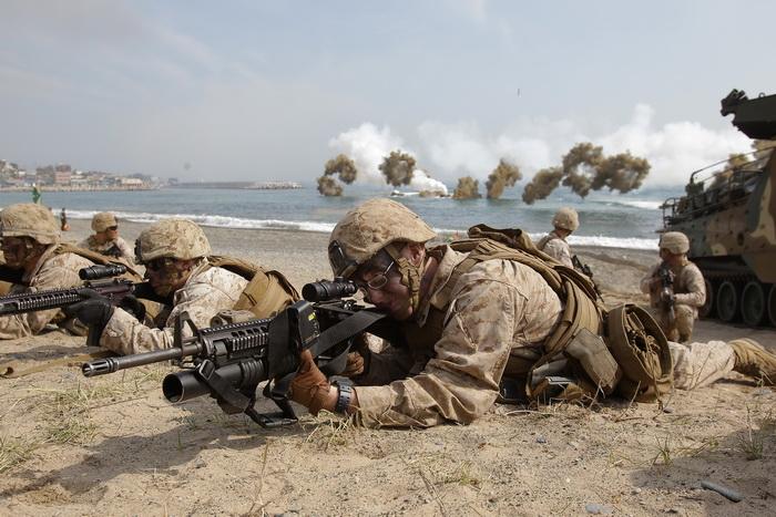 Совместные военные учения Кореи, США и Японии в Пхохане (Южная Корея) 31 марта 2014 года. Фото: Chung Sung-Jun/Getty Images