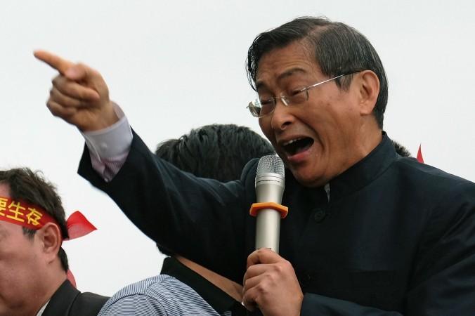 Чжан Ань-ло, прокитайский активист, также известный как «белый волк», выступает в поддержку правительства и спорного торгового соглашения с Китаем, Тайбэй, 1 апреля 2014 года. Фото: Sam Yeh/AFP/Getty Images