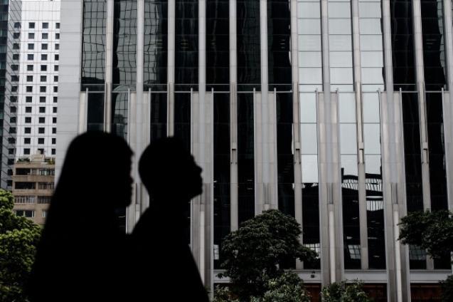 Рост прибыли китайских банков в 2013 году сократился. Фото: Philippe Lopez/AFP/Getty Images