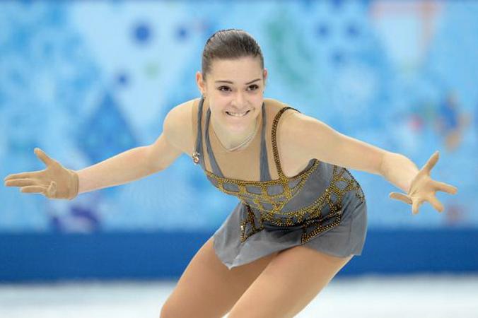 Аделина Сотникова выступила на Олимпиаде с произвольной программой, показав «золотой» результат 20 февраля 2014 года. Фото: YURI KADOBNOV/AFP/Getty Images
