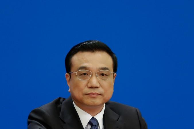 Китайский премьер Ли Кэцян на пресс-конференции после закрытия сессии Всекитайского собрания народных представителей (ВСНП) в Большом зале народных собраний 13 марта 2014 года, Пекин, Китай. Фото: Lintao Чжан/Getty Images
